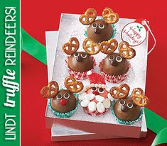 Adorn Lindt chocolate truffles with candy red-hots, mini pretzels, and candy eyes for a cute TRUFFLE REINDEER treat!