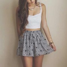 White lace crop top with navy patterned mini skirt
