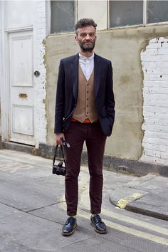 Coggles Street Style with navy blazer, brown waistcoat, white shirt, red belt, burgundy trousers, neon socks and navy brogues. http://www.coggles.com/street-style