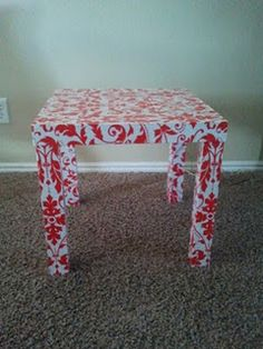 $10 Ikea table, covered with wrapping paper and modge podge! Totally cute!! They look crummy after a while so this is a great idea!