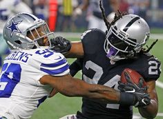 216a4698 Going Beastmode, Marshawn Lynch SHOC visor in 40% smoke vs Dallas Cowboys.  NFL