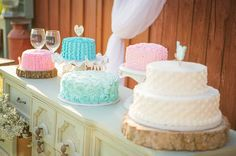 Vintage Rustic Barn Wedding: Wedding cakes with pink, ombre, tiffany blue, turquoise colors and ruffled and rosette buttercream frosting designs.  Beautiful!  www.sueandlou.com