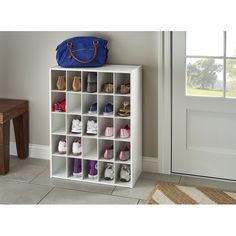Pumps, sandals, boots – even if you're not a shoe collector, it's easy to end up with too many pairs strewn about on your floors. Give all of your kicks a home with a storage unit like this! Crafted from manufactured wood, it features 25 cubbies with room for all your sneakers. Plus, with the closed back and stackable design, you can easily create a tower of shoe storage. If you keep the number of shoes you own to a minimum, this piece is also great for organizing tools, art supplies, and ... Shoe Storage Cabinet, Bench With Shoe Storage, Storage Drawers, Shoe Storage For Closet, Shoe Storage Hacks, Storage Chest, Modular Storage, Cube Storage, Storage Room