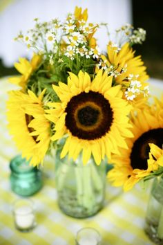 sunflowers in mason jars. Could be different flowers in mason jars! Sunflower Centerpieces, Jar Centerpieces, Wedding Centerpieces, Wedding Decorations, Centerpiece Ideas, Sunflower Decorations, Yellow Wedding, Fall Wedding, Rustic Wedding