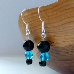 Horrah! Listings done - here's one of the latest additions to my #etsy shop: Black, Marine Blue and Black Round Bead Drop Earrings on Sterling Silver Hooks http://etsy.me/2BbIyDt #jewellery #earrings #black #birthday #sphereball #blue #earwire