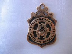 RARE INTERNATIONAL ASSOCIATION OF MACHINISTS ROLLED GOLD FOB DECEMBER 25, 1925