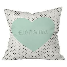 Lend a touch of typographic flair to your sofa, arm chair, or windowseat with this lovely pillow, showcasing a heart and polka-dot motif.  ...