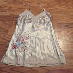 Gold Floral Silky Blouse Gorgeous top that is so silky and comfortable. Great for summer to wear on its own or layer. No longer has a tag visible but fits like a SMALL Tops Tank Tops