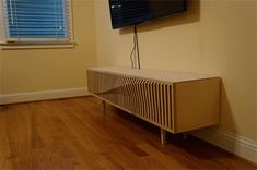 See how this guy designed and made his own TV cabinet