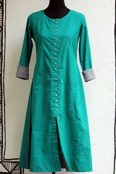 a beautiful tealanarkali with grey mangalgiri border &off-white shell buttons. paired with an pinkchiffon dupatta with grey border! 100% cotton fabric.