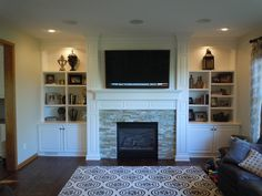 Family room fireplace with custom built-in cabinets and lighting accents.