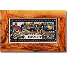 Armenian Ceramic tile portraying the awe-inspiring Holy City of Jerusalem contained within an olive wood frame with a hook on rear to hang on your wall. High quality olive wood from Bethlehem and the Armenian ceramic tile from Jerusalem. Size 8 x 5 inches