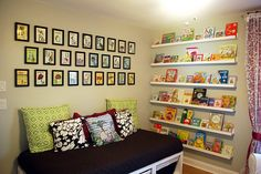 Kids bedroom - under roof reading nook: shelves that enable to display the cover of books rather than just the spines, as kids are more likely to read if they can see the book
