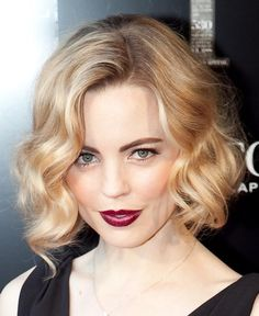 A wavy bob with a dark lip - great for 1920s weddings! Tipi wedding inspiration loved by www.beautifulworldtents.co.uk