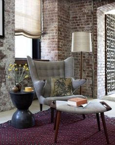 Audacious Living Space Layouts Evoke Ingenious Atmosphere Utilizing Brick Walls: Interesting Room Set With Old Brick Wall And Stylish Chair With Unique Table Also Floor Lamp