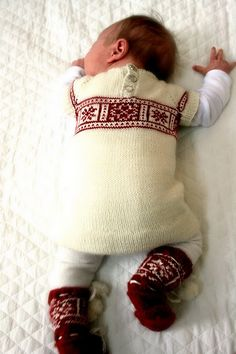 Technically not Fair Isle, but Norwegian intarsia knitting, which is pretty darn close! Darling Dale of Norway revamp.The yarn:Cascade Heritage Solids and Quatro Colors. The needles?  - size 0 and 1.5 (US). The Patterns:Body Voss and Christine's Baby Booties.