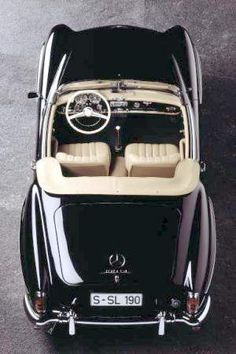 What a pretty car! Needs to be parked in my dream garage attached to my dream house. Sigh!