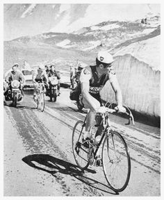 It's the 1967 Tour de France and race leader Roger Pingeon (Peugeot) is in danger of losing his yellow jersey. His friend Raymond Poulidor (Mercier), a very strong climber, drops back on the Galibier and paces him up the mountain. He retains his lead and wins that year's Tour. That year the Tour was being contested by national teams and Raymond and Roger were on the French team.