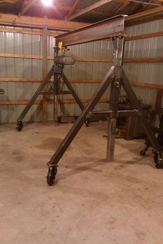 Gantry Crane by bigpappy -- Homemade gantry crane constructed from I-beam, tubing, steel plate, casters, and an electric hoist. http://www.homemadetools.net/homemade-gantry-crane-17