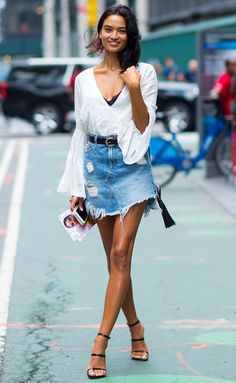 Shanina Sheik in a white wrap top, denim miniskirt and heels - click through for more celebrity outfit ideas