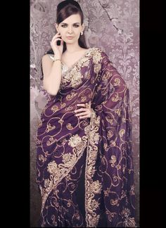 Stunning purple sequined saree. Love this.