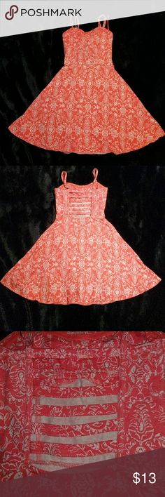 Sundress Coral sundress with a strap back and boning along sides. Adjustable straps and a cryptic design Aeropostale Dresses Casual