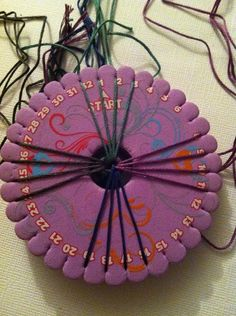 Measure 16 strings, in this case, 4 of each, to 24 inches. Tie a loose overhand knot about 5 inches down. Arrange in groups of four.