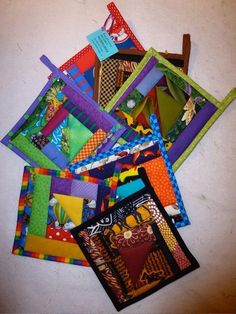 Potholders!  What an awesome idea if you want to quilt but don't have the patience for a huge quilt!