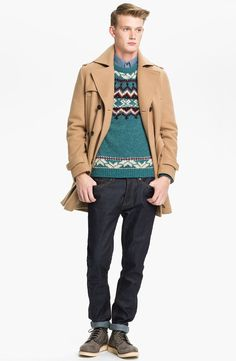 Shop this look on Lookastic: http://lookastic.com/men/looks/longsleeve-shirt-crew-neck-sweater-overcoat-jeans-boots/6983 — Blue Chambray Long Sleeve Shirt — Teal Fair Isle Crew-neck Sweater — Camel Overcoat — Black Jeans — Charcoal Leather Boots