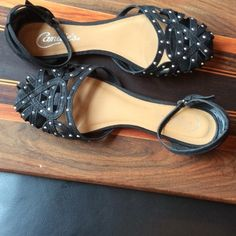 Candies Ankle-Strap Silver Stud Flats Shiny metal embellishments and ankle straps make the shoes cute to wear with shorts or short skirts. These sandals have been worn only once. Man-made materials. Candie's Shoes Sandals