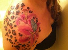 lily-cheetah-print-tattoo - 30+ Cheetah and Leopard Print Tattoos for Women | Art and Design