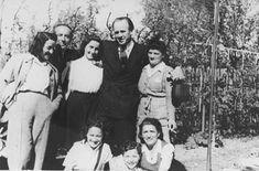 Oskar Schindler standing (second from right) with some of the people he rescued. Munich, Germany, 1946. This Day in History: Oct 9, 1974: Oskar Schindler dies