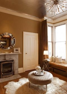 Gold walls and gold ceiling with white crown molding. Redoing my room like this with blue and dark brown accents :)