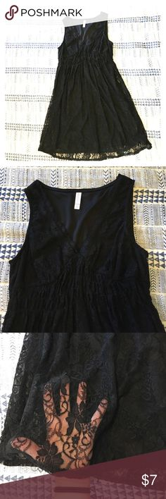 Black lace overlay junior's dress Stretchy lace over polyester lining. Flattering stretch around bust with empire waist. Xhilaration Dresses