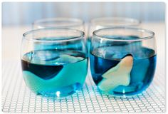 "Fill small Glad FreezerWare containers with water to nearly the top and a few gummy sharks to create playful ""glaciers"" with sharks suspended inside. Place containers in freezer. Once frozen solid, pop the glaciers out of the containers and float them in big bowls of sparkling blue-raspberry punch."