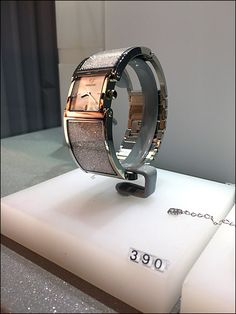 What caught my eye was the uncharacteristic use of grey in this Swarovski® Wrist Watch display fixture. In my experience, white is the consistent color for stationary Swarovski fixtures, black and . Watch Display, Wrist Watches, Visual Merchandising, Stationary, Swarovski, Rings For Men, Eye, Color, Black