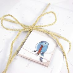 Wrapping paper with footprints in the snow and gift tag with a lovely bird // by Bow & Hummingbird