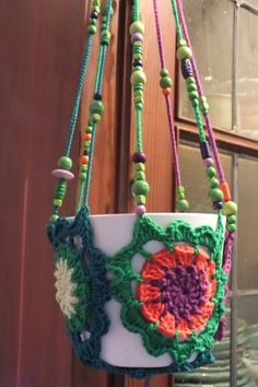 gehäkelte Blumenampel Handarbeit Baumwolle