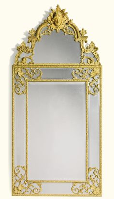 Acarved giltwoodmirror in Régence style | Sotheby's