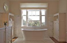 Suzie:  Brooke Giannetti.  freestanding chic tub, white silk roman shade, ivory bathroom cabinet ...