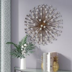 Add a pop of style to your master suite or living room with this glamorous wall showcasing a sunburst motif in bronze. Wall Decor Online, Wall Decor Set, Metal Wall Decor, Starburst Wall Decor, Medallion Wall Decor, Paper Stars, Decoration, Decorative Pillows, Wall Décor
