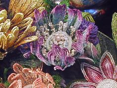 Beaded flowers by Mario Rivoli. I LOVE the usage of color in these flowers French Beaded Flowers, Wire Flowers, Felt Flowers, Seed Bead Jewelry, Seed Beads, Beaded Jewelry, Jewelry Rings, Lesage, Flower Bracelet