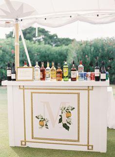 Creative Florida orange inspired bar station: http://www.stylemepretty.com/2016/12/20/citrus-infused-florida-wedding/ Photography: Jacqui Cole - http://jacquicole.com/