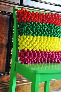 DIY pom pom pillow..no tutorial...website said it likes to spam. but this looks pretty easy to do.