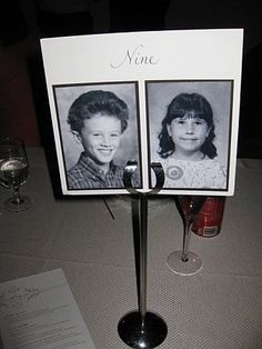 table numbers with pics of bride and groom at that age - hahaha cute.