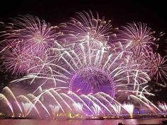 Fireworks light up the sky over the London Eye in central London during the New Year celebrations Thursday Jan. 1, 2015.