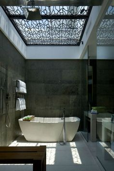 """via: interiorcollective - love the """"grillwork"""" under the skylight.  It softens the light just enough. #bathroom #design"""
