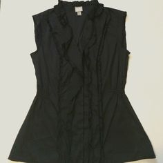 Black Ruffled Blouse Black ruffled sleeveless blouse. Washed but never worn. 100% polyester and machine washable. Measures approx 24 1/2 inches top to bottom and 16 1/2 arm pit to arm pit. Offers are welcome but I do not trade Converse Tops Blouses