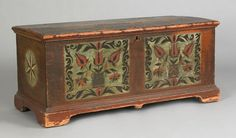 Jonestown, Lebanon County, Pennsylvania dower chest by Christian Selzer, ca. 1780, the lid decorated with 2 floral panels, over a case, the front with 2 rectangular panels with potted tulips within a foliate scroll border, the left pot is signed indistinctly, flanked by sides with black and white pinwheels, all on a stippled ground supported by short bracket feet, 20 h., 43 3/4 w.