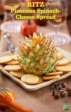Our RITZ cracker Pinecone Spinach-Cheese Spread is a simple appetizer for any holiday party. Blend spinach, oil, and garlic in a food processor, adding cream cheese, a shredded Italian cheese blend, and grated Parmesan once mixed. On wax paper, shape into a 4-inch oval then insert nuts in rows to completely cover the mixture. Refrigerate for two hours and serve with your favorite RITZ crackers. 'Tis the season to decorate your food!